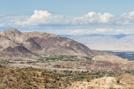 wintering: view of the desert valley from the top of a mountain in southern California, green Golf Courses in the desert.