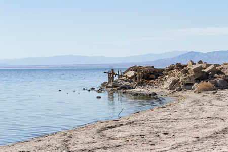 destructed: the remains and standing frames in the once popular town Bombay Beach in the Salton Sea, California. Stock Photo