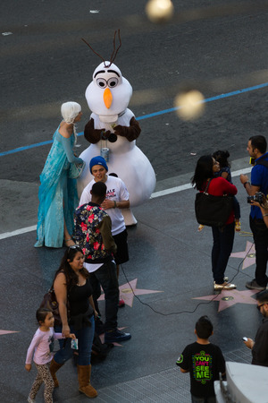 blvd: Hollywood Blvd, LA, California - February 08 : People dressed as the Character of Frozen Elsa and Olaf posing with tourist for a tip, February 08 2015 in Hollywood Blvd, LA, California.