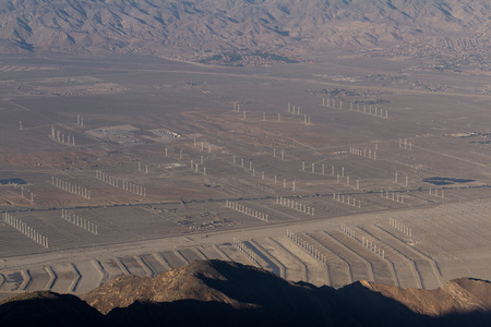windy energy: View of the Coachella Valley in California with a thick and dense smog layer and windmill farms in the valley floor and lower hills