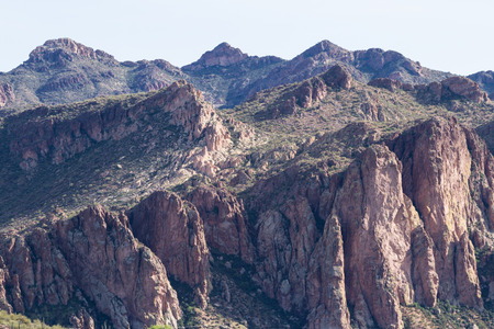 wintering: Arizona mountain landscape in springtime with greenery on the red rock cliffs