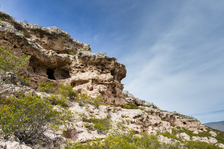 ravel: well hidden Cliffs Dwellings in Arizona, shot is springtime with greenery