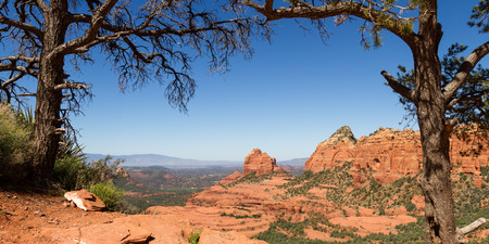 nestled: beautiful landscape with red rock formations and the city of Sedona nestled in the valley