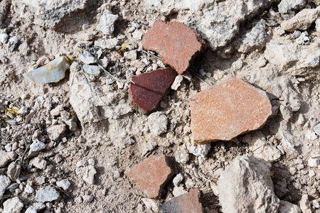 clues: close up of small pieces of pottery left behind on the desert ground for hundreds of years in Arizona