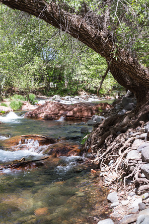 downstream: clear clean water flowing downstream over smooth rocks in Sedona Arizona