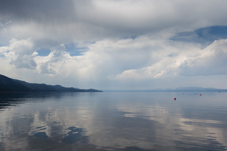 north end: scenic view of Lake Tahoe with clouds and haze from the north end of the lake Stock Photo