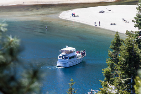 fannette: Lake Tahoe, California - April 29 : tout boat near the shore of Emerald Bay, April 29 2015 Lake Tahoe, California. Editorial