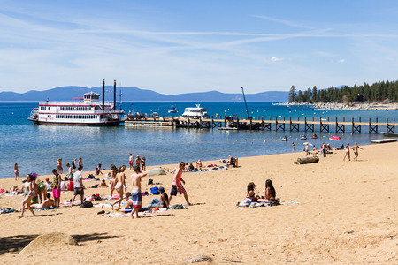 clear day in winter time: Lake Tahoe, Nevada - April 28 : Spring Break, College students enjoying a day at the beach, April 28 2015 Lake Tahoe, Nevada.