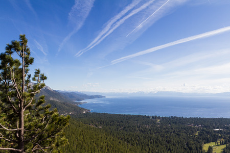 climate change: Beautiful Lake Tahoe with chemtrails across the blue sky