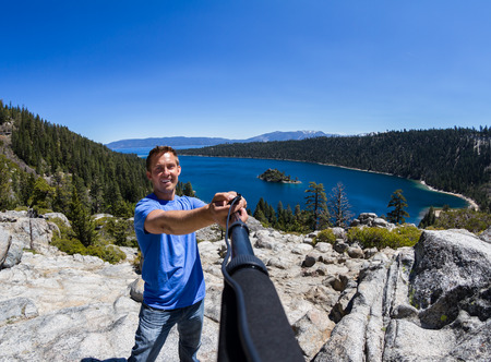 fannette: young man akin a selfie with Fannette Island and Emerald bay in the background