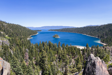 fannette: view of emerald bay in Lake Tahoe on a early spring afternoon, a calm lake and fresh green on the trees Stock Photo