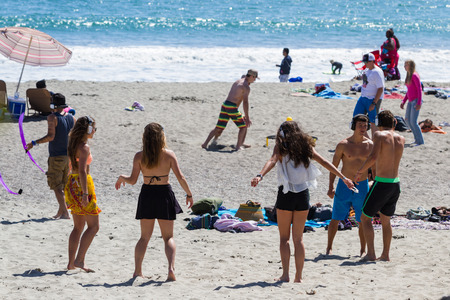 luis: San Luis Obispo, California - young adults having fun and dancing on the beach wearing headphones in a hush concert, May 03 2015 San Luis Obispo, California. Editorial