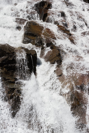 close up of a rock in Eagle Falls, Lake Tahoe with fas flowing clean water