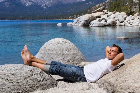 Adult male relaxing in Lake Tahoe enjoying the sunshine