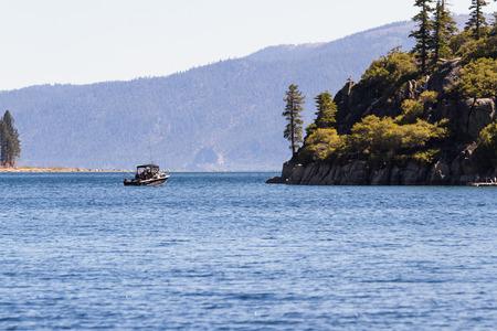 fannette: Lake Tahoe, California - April 29 : Fishing near Fannette Island on a small boat in a beautiful day, April 29 2015 Lake Tahoe, California.