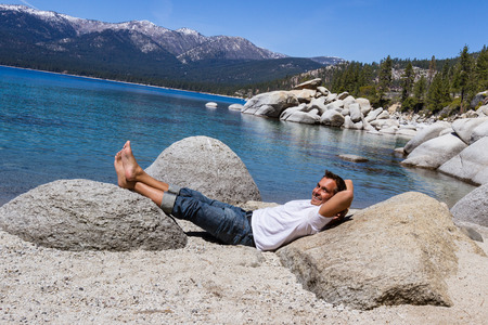 clear day in winter time: Adult male relaxing in Lake Tahoe enjoying the sunshine