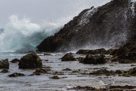 california coast: powerful waves splashing on large rocks in the California Coast Stock Photo