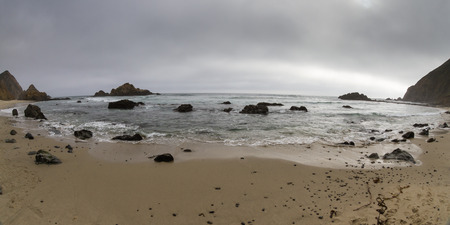 big sur: relaxing beach in Big Sur California with a dense fog in the horizon and calm waves Stock Photo