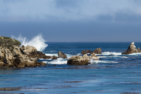 california coast: dramatic powerful waves crashing on rocks of the California Coast
