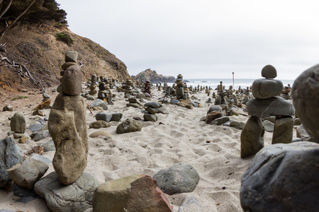 stacked rocks left behind by people as an art form in the California Coast