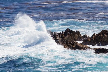 waves crashing: dramatic powerful waves crashing on rocks of the California Coast