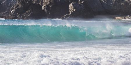 california coast: California coast landscape with large rocks and waves splashing with drama Stock Photo