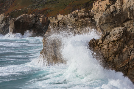 large rocks: large rocks and powerful waves in a dramatic display classic of the California coast Stock Photo