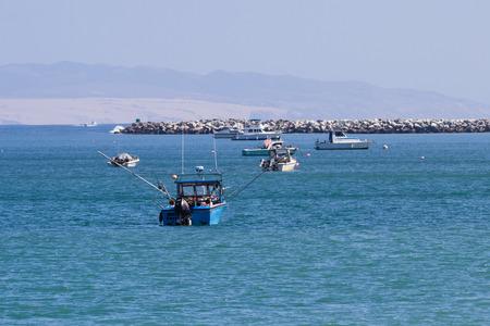 luis: San Luis Obispo, California - Fishing boats on beautiful blue waters in California, May 03 2015 San Luis Obispo, California.