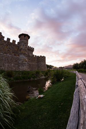 mote: Castle in Napa Valley at sunset with a reflection on the mote