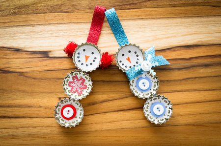 cute hand made recycled christmas ornaments on a wooden table Archivio Fotografico