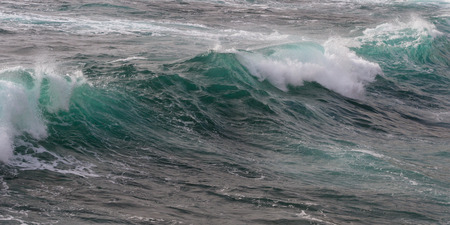 spay: close up shot of a crashing wave as a background