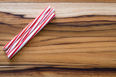 stripped: holiday background with stripped peppermint sticks on a wooden background