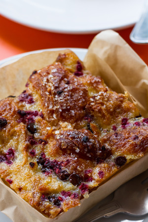 close up of a home made bread pudding with fresh berries i it