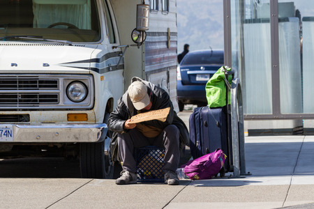 beggars: San Francisco, California - May 11 : Homeless man on a sidewalk with a sign asking people for help, May 11 2015 San Francisco, California.