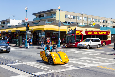 rentals: San Francisco, California - May 11 : Young girls in a rental go cart driving and exploring the city, May 11 2015 San Francisco, California. Editorial