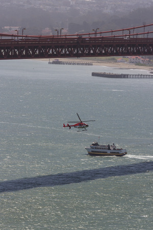 thrilling: San Francisco, California - May 11 : Helicopter flying under the Golden gate Bridge for a thrilling tour, May 11 2015 San Francisco, California. Editorial