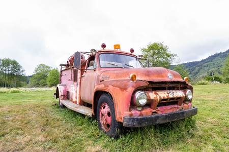 rusting: Klamath, California - June 16 : Old ford fire truck rusting away in a meadow, June 16 2015 Klamath, California.
