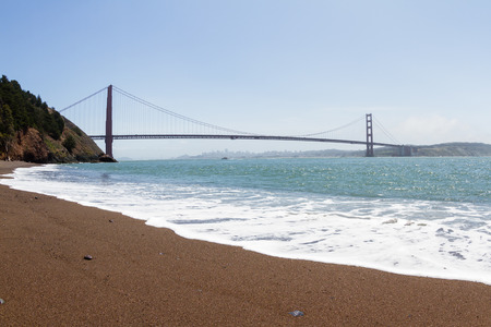 lingering: View of the Golden Gate Bridge with fog lingering over the city in the background Stock Photo