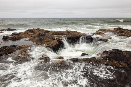 feature: Feature known as Thors Well in the central Oregon coast with a drama and natural wonder