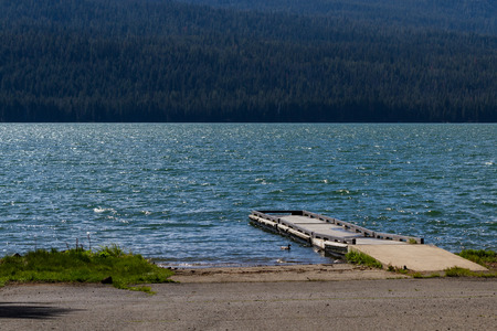 rough diamond: windy day in Diamond Lake Oregon, view of the dock with rough waters Stock Photo
