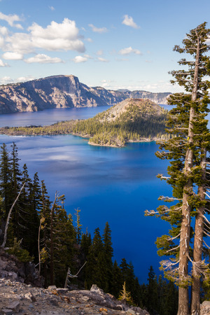 crater lake: Beautiful landscape in Crater Lake with a deep blue color in the lake and wizard Island in flu sunshine Stock Photo