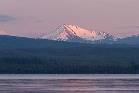 scott: snow caped mount Scott from across Damond Lake at sunset Stock Photo