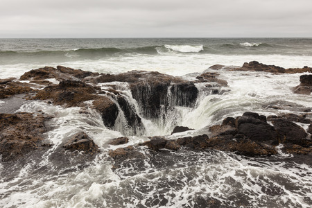 thor's: Feature known as Thors Well in the central Oregon coast with a drama and natural wonder