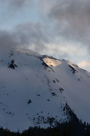 close up of Mount Bailey covered in snow in springtime shot at sunset Stock Photo