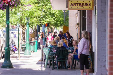 alene: Coeur d Alene, Idaho - June 12 : Summertime in Sherman Ave with people relaxing and walking on the sidewalk, June 12 2015 in Coeur d Alene, Idaho Editorial