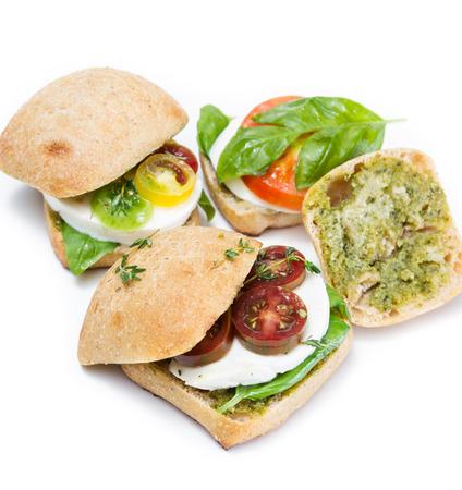 sliders: sliders with fresh mozzarella, tomato and fresh basil on a white background