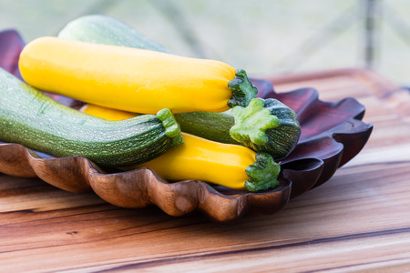 freshly picked: close up of a bunch of freshly picked organic green and yellow zucchini
