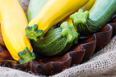 plater: close up of a bunch of freshly picked organic green and yellow zucchini