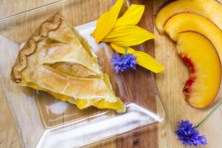 sourced: slice of home made peach pie served on a clear plate