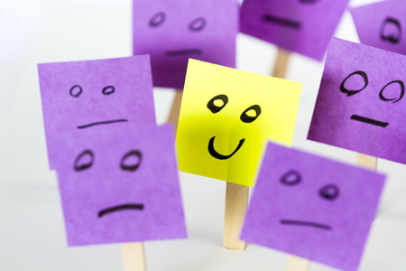 conceptual ideas: conceptual image for a be different or be happy concept using sticky notes